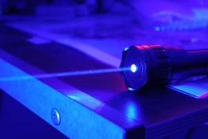 "1.2W Class 4 Very High Power Blue Laser, Dark Background. Andrew ""FastLizard4"" Adams on Flikr. https://www.flickr.com/photos/fastlizard4/5660747232"