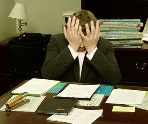 "By LaurMG. - Cropped from ""File:Frustrated man at a desk.jpg""., CC BY-SA 3.0, https://commons.wikimedia.org/w/index.php?curid=20367001"